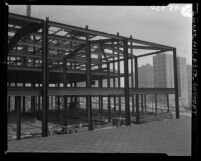 Know Your City No.127; Construction of steel framework of Los Angeles County Courthouse at 1st and Hill Streets, 1956