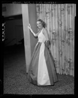 Los Angeles Junior League member, Elizabeth Bell, modeling evening gown designed by Galanos, 1955