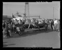 Crowd viewing a 20-foot basking shark caught by fishermen in Long Beach, Calif., 1955