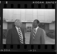Ivan Houston and Larkin Teasley of Golden State Mutual Life Insurance Co. standing before company's building in Los Angeles, Calif., 1984