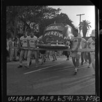 "University of Southern California Kappa Alpha fraternity men carrying a Volkswagen Beetle in ""Volks-toting"" race, 1964"