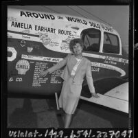Pilot Joan Merriam Smith besides plane she flew solo around the world, Los Angeles, Calif., 1964