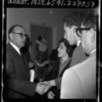 Governor Edmund G. (Pat) Brown talks with Doris Savio after free speech meeting with UC Board of Regents, 1964