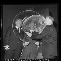 Bart Lytton, Dr. Clair O. Musser and Clarence H. Cleminshaw demonstrating the Musser Copernican Planetarium at Griffith Observatory, Los Angeles, 1965