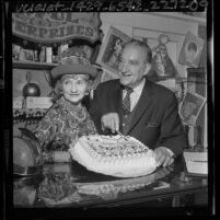 Actor Francis X. Bushman and wife Ivy, cutting cake on his 82nd birthday in Los Angeles, Calif., 1965