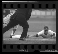 Maury Wills sliding into first base during Los Angeles Dodgers game in 1965