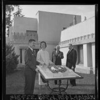 Paul Hunter, Paul R. Williams, Eunice Goodan and Herbert Kahn display model of Los Angeles Junior Arts Center at Hollyhock House, Los Angeles, 1965