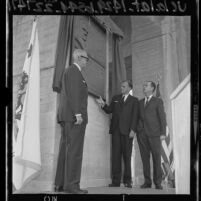 Evangelist Billy Graham,  Kenneth Hahn and A. E. England unveiling commemorative plaque at Los Angeles Memorial Coliseum, 1965
