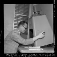 San Fernando Valley State College's Dr. Vern L. Bullough studying microfilm of rare science books, 1965