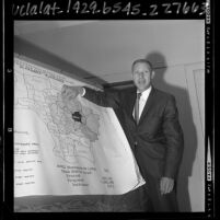 R. B. Rose of the Pacific Telephone Company explaining map outlining toll calls in Alhambra, Calif., 1965