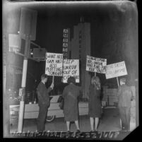 Four pickets at outside a Democratic Ball at Ambassador Hotel in Los Angeles, Calif, 1965
