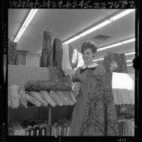 Miss America of 1965 Vonda Kay Van Dyke at a fabric store in Los Angeles, Calif.