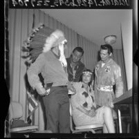 Four American Indian actors in ethnic dress at news conference about lack of work in Los Angeles, Calif., 1965