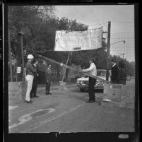 "San Fernando Valley State College students manning mock ""Berlin Wall"" 1965 Freedom Week in Encino, Calif., 1965"