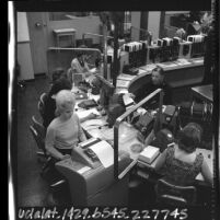 Dispatchers using California's Auto-Statis computer system at Los Angeles Police dispatch center, 1965