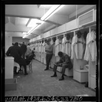Baseball players in street clothes in California Angels locker room, 1965