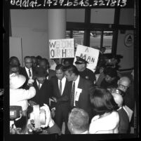 Dr. Martin Luther King being greeted by crowd upon his arrival at Los Angeles airport, 1965