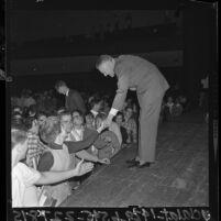 Ambassador to Vietnam, Henry Cabot Lodge Jr. shaking hands with UCLA students, 1965