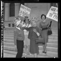 Four women demonstrating at Los Angeles City Hall in favor of Santa Monica Mountain park site., 1965