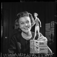 Barbie's first clothing designer Charlotte Johnson posing with 1965 Barbie doll model