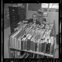Helge Hansen, exchange librarian from Denmark, sorting book trucks in Hawthorne, Calif., 1965