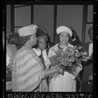 Coretta Scott King receiving flowers upon arrival at Los Angeles airport, 1965