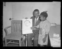 UCLA professor, Dan Kunene with his daughter Leziwe and one of her drawings in Los Angeles, Calif., 1965