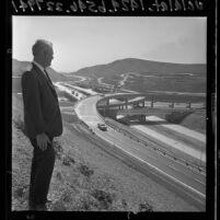 Bill Lloyd looking over Long Beach and San Bernardino Freeways interchange on opening day, 1965