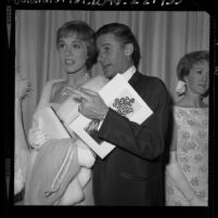 "Actors Roddy McDowall and Julie Andrews at the ""The Sound of Music"" film premiere in Los Angeles, Calif., 1965"