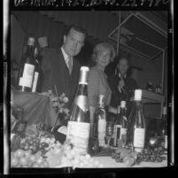 Author and restaurateur, Robert L. Blazer discussing wine at Epicure's Enterprise in Los Angeles, Calif., 1965