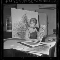 Artist June Wayne sitting amongst lithographs at Tamarind Workshop, Los Angeles, Calif., 1965