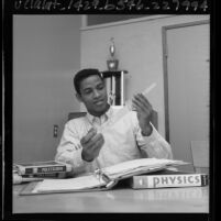Long Beach Polytechnic High School athlete Gene Washington studying, 1965