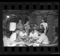 UCLA students playing cards in ski lodge at June Mountain, Calif., 1965