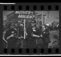 Women Strike for Peace members dressed in black carrying roses and signs during march in Los Angeles, Calif., 1965