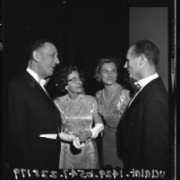 Norton and Lucille Simon talking to unidentified couple at party for Los Angeles County Museum of Art, 1965