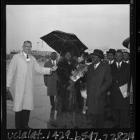 President Maurice Yaméogo of Upper Volta and wife being greeted at Los Angeles airport by Walter Coombs, 1965