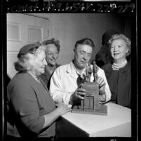 Sculptor Henry Van Wolfe with members of North Hollywood Women's Club viewing model of Treaty of Cahuenga statue, 1965