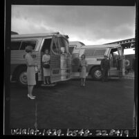 Three female USC alumni boarding buses going to Los Angeles Songfest, 1965