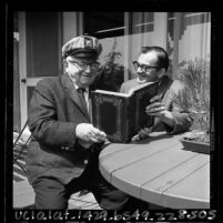 Book dealer Adolph A. Kroch and librarian John E. Smith at UC Irvine, 1965