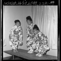 Three Japanese American girls in kimonos dancing at Japanese Children's Day, Los Angeles, Calif., 1963