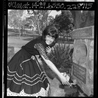 Woman at fountain of Aqua je de Centinela - Centinela Springs at Centinela Park, Inglewood, Calif., 1965