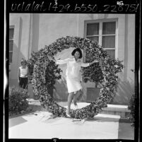 USC Tri-Delta Sorority member passing through ring at 42nd annual Pansy Ring Ceremony, 1965