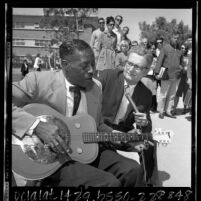 Blues guitarist Son House playing as professor Dr. D. K. Wilgus records music at 3rd annual UCLA Folk Festival, 1965