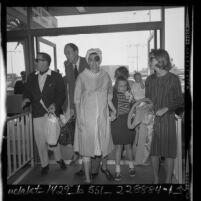 Actress Patricia Neal, first appearance after stroke, with her husband Roald Dahl and children at airport in Los Angeles, Calif., 1965