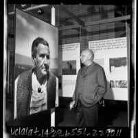 Composer Virgil Thomson studying large photograph of Gertrude Stein at UCLA exhibit, 1965
