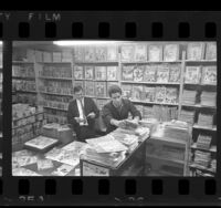 Burt Blum and Rick Durell looking through comic books at Cherokee Book Shop in Los Angeles, Calif., 1965