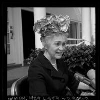 Ivy Baker Priest, the former treasurer of the United States wearing hat made of dollar bills, 1965