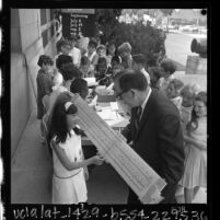 William F. Fitzgerald showing giant slide rule to students at California Museum of Science and Industry, Los Angeles, 1965