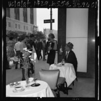 Two female musicians entertaining passersby in front of Los Angeles office of Air France on Bastille Day, 1965