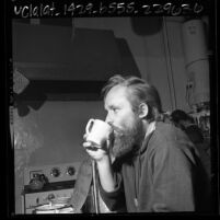 "Bearded man drinking coffee at Venice West Coffee House, ""beatnik"" café in Venice, Calif., 1965"